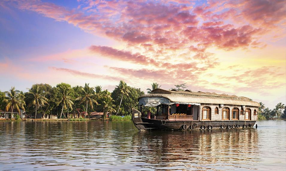 Cruise through the backwaters of Kerala on a traditional houseboat.