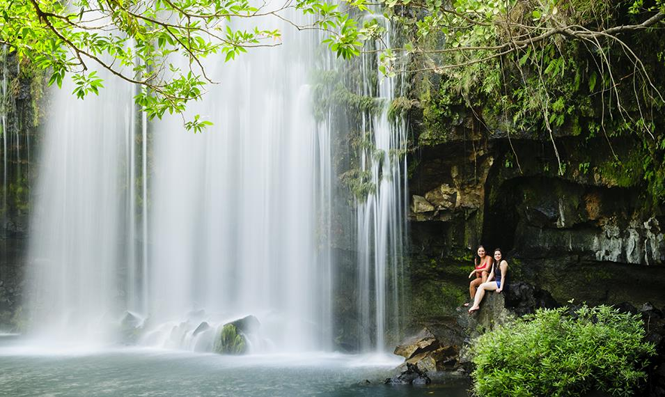Trek through lush forest to remote waterfalls.