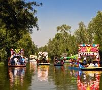 Highlights of Mexico: Art & Archaeology Tours 2019 - 2020 -  Trajineras in Xochimilco