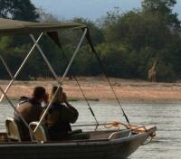 Untouched Tanzania Tours 2019 - 2020 -  Boat safari - giraffe sighting